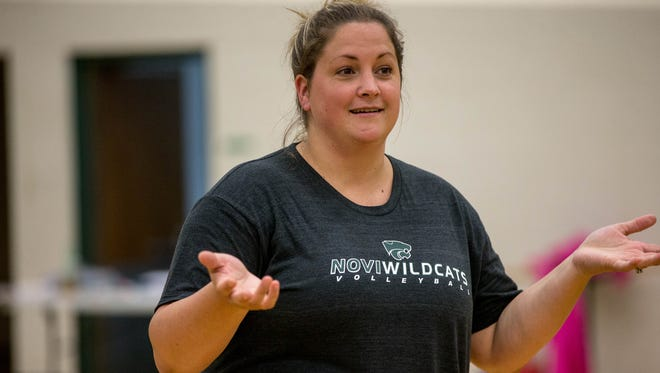 Novi volleyball coach Jennifer Cottrill leads volleyball tryouts at Novi High School on Wednesday, Aug. 10. 2016.