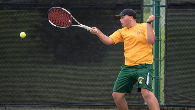 Pennfield High School junior Joe Larsen during the All-City Tennis Tournament on Aug. 26.