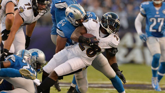 Lions linebacker DeAndre Levy tackles Ravens RB Terrance West in a 2016 exhibition game.