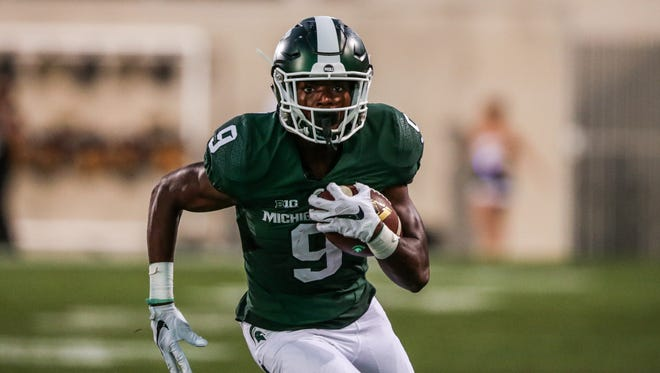 Michigan State Spartans true freshman receiver Donnie Corley runs with the ball against the Furman Paladins during the opener at Spartan Stadium in East Lansing on Sept. 2, 2016.