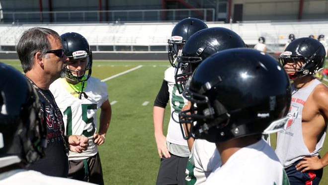 Head Coach Jeff Flood talks to his players during football practice at North Salem High School on Wednesday, Aug. 17, 2016.
