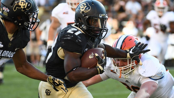 Sep 10, 2016; Boulder, CO, USA; Colorado Buffaloes running back Kyle Evans carries the ball during the second half against the Idaho State Bengals at Folsom Field.