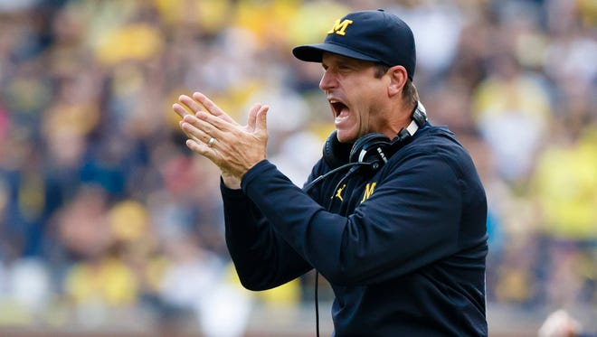 Sep 10, 2016; Ann Arbor, MI, USA; Michigan Wolverines head coach Jim Harbaugh claps after a touchdown in the second half against the UCF Knights at Michigan Stadium.