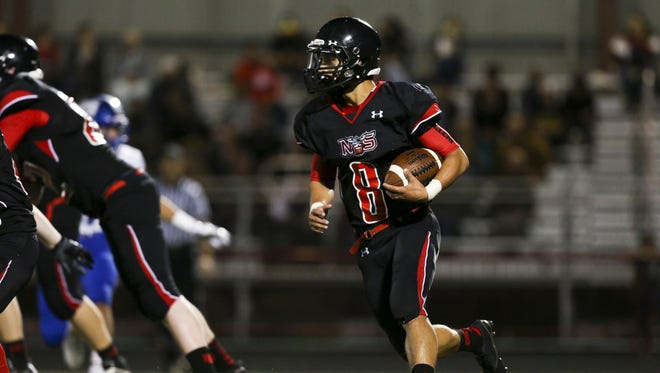 North Salem running back Alex Vasquez (8) looks for a way through the line in the season opening-game on Friday, Sept. 2, 2016, at North Salem High School. McNary won the match-up 38-35.