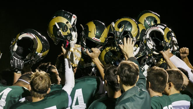 The Regis Rams huddle up following a game against Dayton on Friday, Sept. 9, 2016, at Regis High School in Stayton. Visiting team Dayton beat the Regis Rams 16-13.