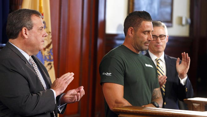 Former heroin addict Rich Wilder is applauded by NJ Governor Chris Christie (left) and former Governor Jim McGreevey during a Statehouse news conference in Trenton Tuesday, September 27, 2016. The Jackson Township resident's story of addiction and recovery was highlighted during the event that discussed the state's efforts against drug abuse.