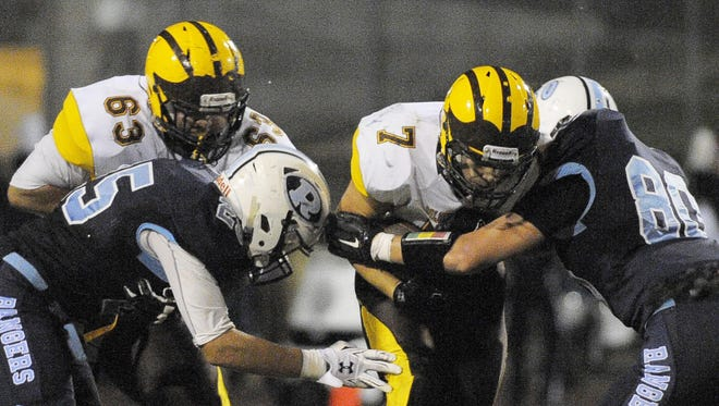 Golden West's Gonzalo Rodriguez rushes against Redwood in last season's game. Redwood won 17-8.