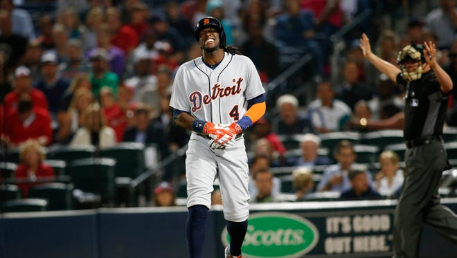 Tigers centerfielder Cameron Maybin (4) reacts after being hit by a pitch against the Atlanta Braves in the sixth inning of the Tigers' 6-2 win over the Braves Friday in Atlanta.