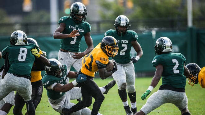Detroit King RB Kevin Willis is tackled by Detroit Cass Tech DB Jimmy Garner on Saturday, October 1, 2016, in Detroit.