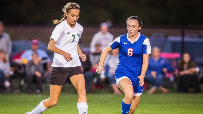 Yorktown's Hannah Rapp dribbles against Jay County at the Yorktown Sports Park Tuesday, Oct. 4, 2016.