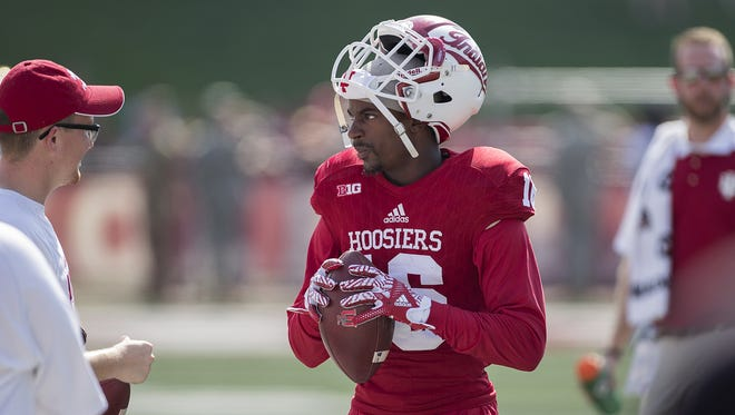 FILE — Hoosiers defensive back Rashard Fant raised his fist during the national anthem at Saturday's game at Ohio State.
