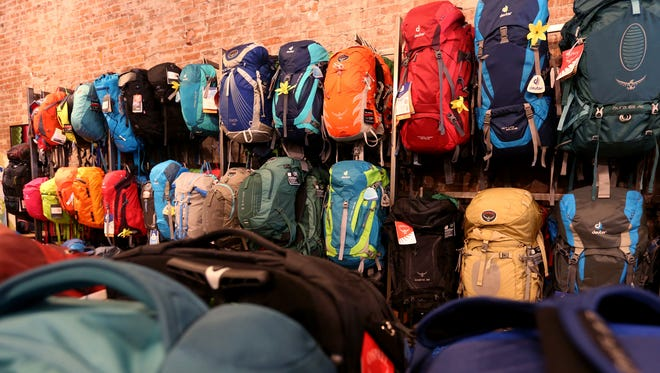 Backpacks line the wall at Salem Summit Company in downtown Salem. Photographed on Wednesday, Oct. 12, 2016.