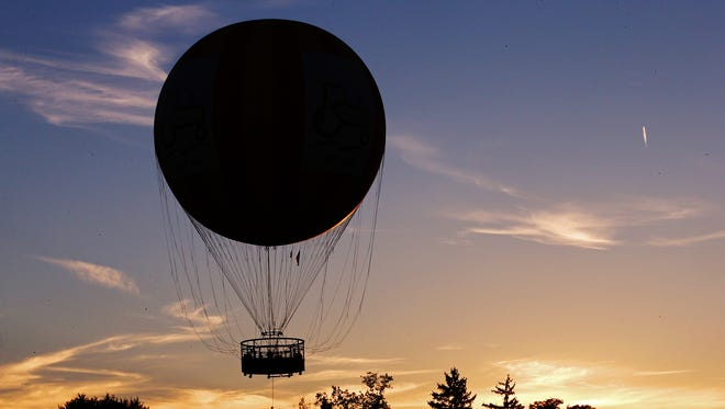 The 1859 balloon voyage rises in front of the sunset on opening night of Headless Horseman Nights at Conner Prairie, Fishers, Ind., Thursday, October 13, 2016.