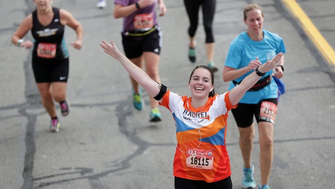 Rachel Mundy of Northville crosses the finish line for the half marathon during the 39th Annual Detroit Free Press/Talmer Bank Marathon in Detroit on Sunday, Oct. 16, 2016.