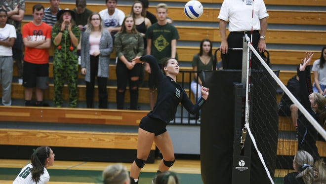 West Salem's Kasey Campbell (2) spikes the ball to South Salem in a game on Tuesday, Sept. 6, 2016, at West Salem High School. The West Salem Titans won the match 3-1.