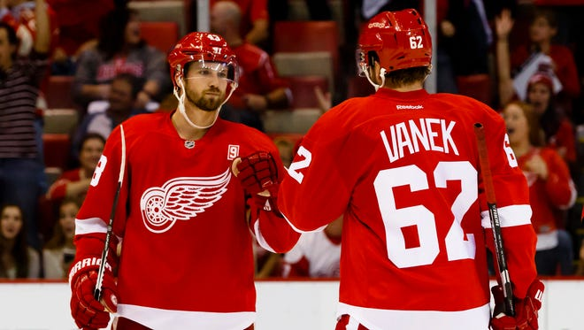 Detroit Red Wings center Darren Helm, left, receives congratulations from left wing Thomas Vanek after scoring in the third period against the Ottawa Senators on Oct. 17, 2016, at Joe Louis Arena.