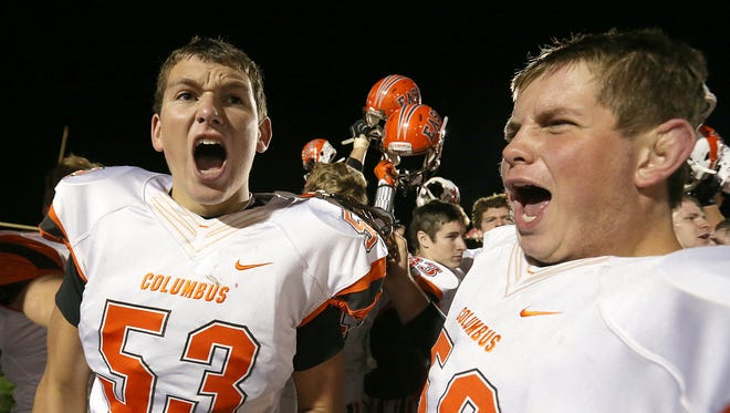 Columbus East Olympians Seth Turner (53) and Columbus East Olympians Austin Scheckles (58) celebrate after defeating the New Palestine Dragons in New Palestine, Ind., Friday, October 21, 2016. Columbus East won, 35-7.