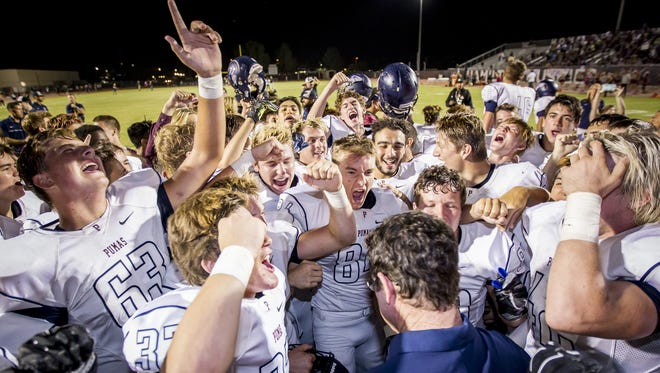 Perry celebrates after defeating Hamilton 55-21 at Hamilton high school on Friday, October 21, 2016 in Chandler, Arizona.