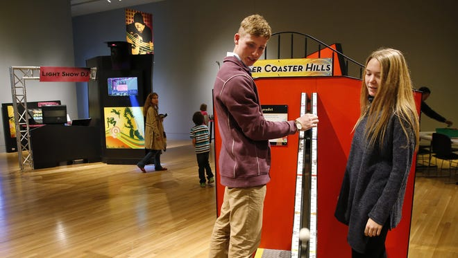 "Nick Piper and Sam Nosler play on the ""Roller Coaster Hills"" using math and physics skills at the Indiana State Museum."