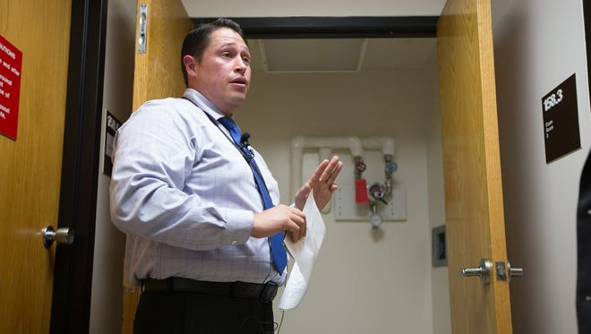 Reynaldo Leal, public affairs officer for the VA Texas Valley Coastal Bend, on Thursday, Oct. 27, 2016, leads a tour of a room where mold was found after an air quality complaint was made at the Corpus Christi Outpatient Clinic.
