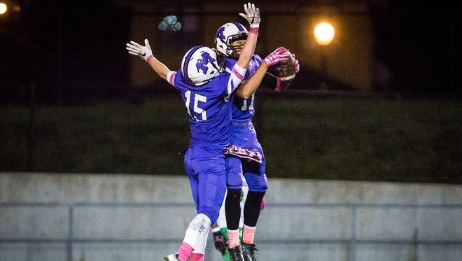 Central's Eliseus Young and Andrew Stephenson celebrate a touchdown against Anderson during their game at Central Friday, Oct. 28, 2016.