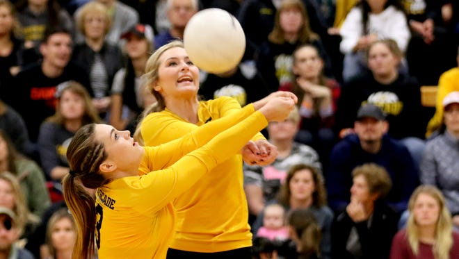 Cascade's Meriah Kindell (3) and Tori Lewis (7) both go after the ball in the Henley vs. Cascade volleyball match, in the first round of 4A playoffs, at Cascade High School in Turner on Saturday, Oct. 29, 2016.