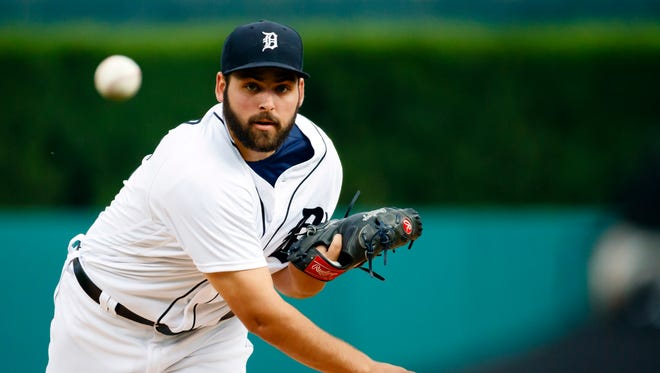 Jun 6, 2016; Detroit, MI, USA; Tigers rookie pitcher Michael Fulmer warms up before the first inning against the Toronto Blue Jays at Comerica Park.
