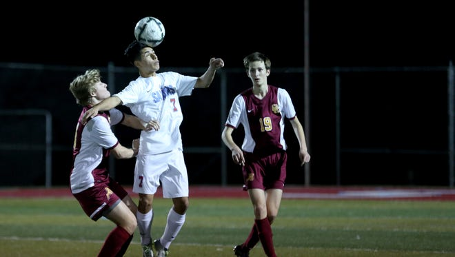 South Salem's Isai Juarez Mendoza (7) goes up for the ball between Central Catholic's Anthony Gianotti (14) and Reece Cole (19) in the Central Catholic vs. South Salem boy's soccer game in the second round of 6A playoffs at South Salem High School on Wednesday, Nov. 2, 2016. Central Catholic won the game 9-8 after 11 rounds of penalty kicks.