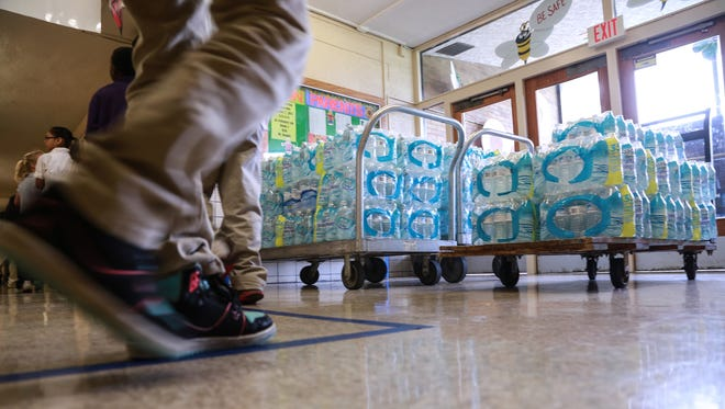 A federal judge has ordered state officials to deliver bottled water to Flint residents who don't have properly installed and maintained water filters on their kitchen taps.