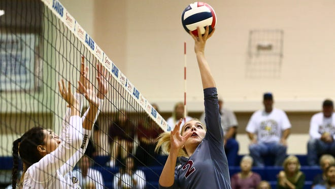 Calallen's Kaycee Brimhall hits the ball over the net during their match against Seguin in the Region IV-5A girls volleyball tournament at Dugan Wellness Center on Friday, Nov. 11, 2016.
