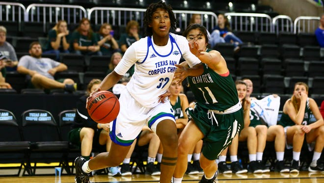 Texas A&M-Corpus Christi's Dalesia Booth drives the ball to the basket as Montana Tech's Kemi Heng guards her during the second quarter at the American Bank Center on Wednesday, Nov. 23, 2016.