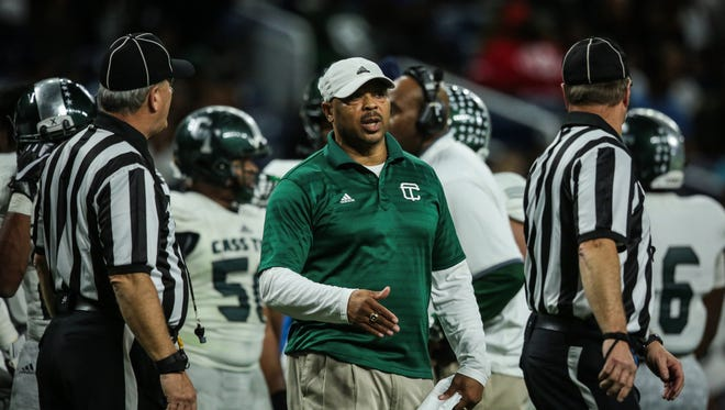 Detroit Cass Tech coach Thomas Wilcher speaks to the referees during the Division 1 High School Championship game against Detroit Catholic Central on Nov. 26, 2016 at Ford Field in Detroit.