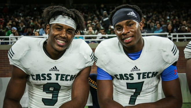 Detroit Cass Tech's Donovan Peoples-Jones (9) and Hall Rodney (7) on the bench during the Division 1 High School Championship game against Detroit Catholic Central on Saturday November 26, 2016, at Ford Field in Detroit, MI.