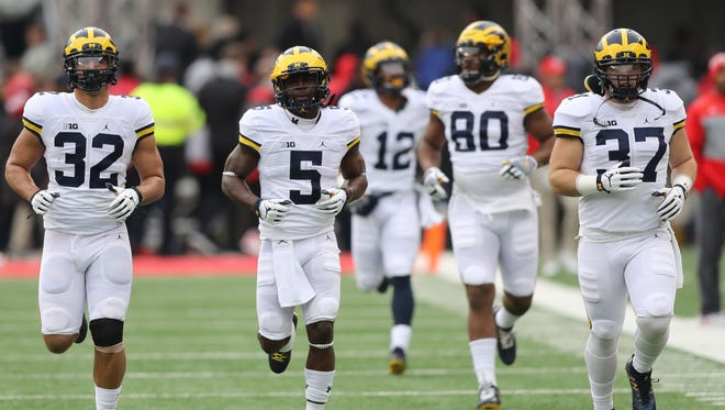 Michigan, led by Jabrill Peppers (5), takes the field for the game against Ohio State on Saturday, Nov. 26, 2016 at Ohio Stadium in Columbus, Ohio.