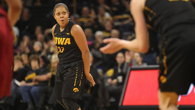 Iowa's Tania Davis celebrates a basket in the final seconds of the first half of the Hawkeyes' game against Iowa State at Carver-Hawkeye Arena on Wednesday, Dec. 7, 2016.