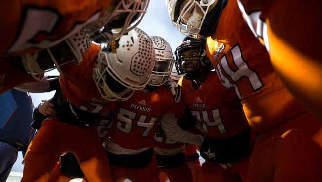 Refugio huddles before taking the field for the Class 2A Division I state semifinal game against Centerville at Rattler Stadium in San Marcos on Friday, Dec. 9, 2016.