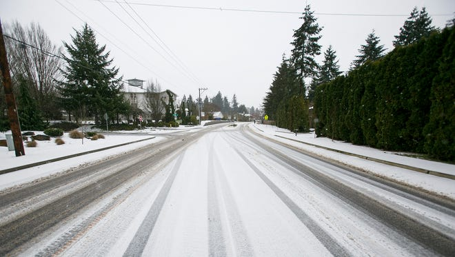 Snow begins to cover Skyline Road South in Salem on Wednesday, Dec. 14, 2016.