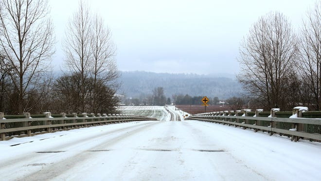 Snow blankets a bridge over the Willamette River near Independence on Thursday, Dec. 15, 2016.