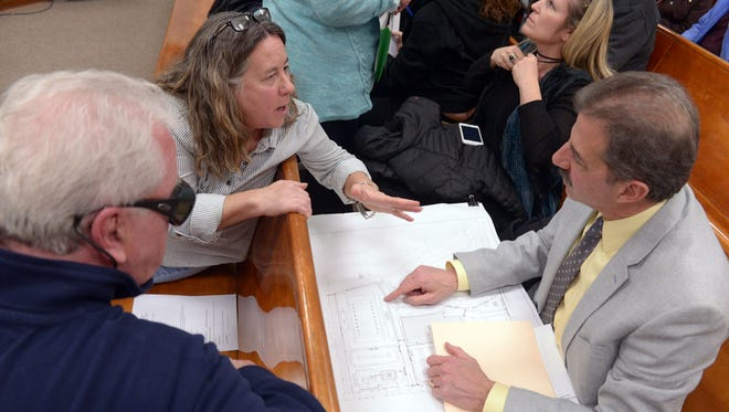 Michael J. Gradaleta, an architect, discussing the options with John Rutledge, left, and Donna Tomasini before the New Milford Council meeting on Wednesday.
