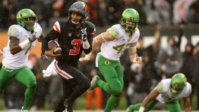 Oregon State's Marcus Maryion (3) rushes in the second half of the Oregon vs. Oregon State Civil War football game at Oregon State University in Corvallis on Saturday, Nov. 26, 2016. The Beavers won 34-24.