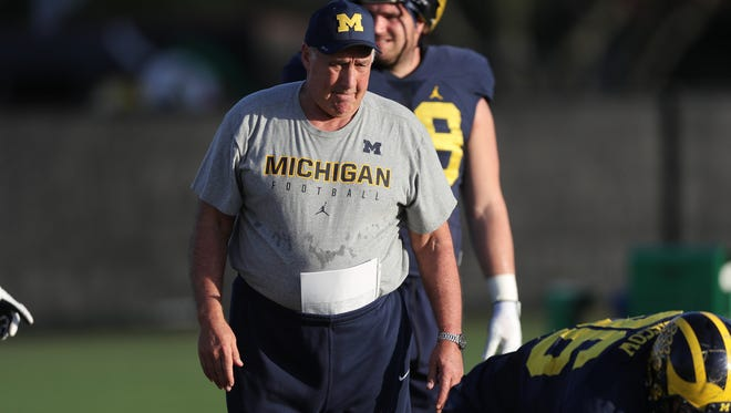 Michigan Wolverines defensive line coach Greg Mattison watches drills during practice for the Orange Bowl against Florida State on Dec. 27, 2016 at Barry University in Miami Shores, Fla.
