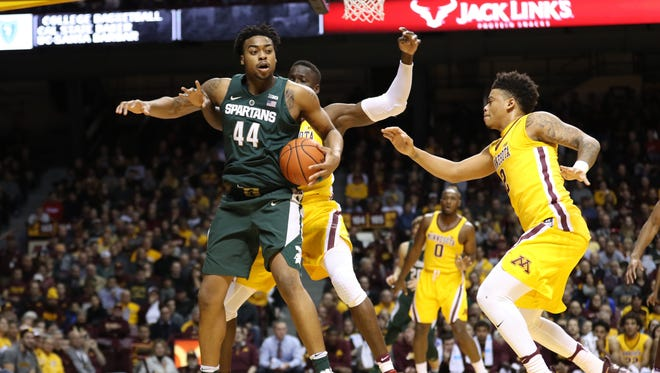 Michigan State forward Nick Ward (44), while being guarded by Minnesota's Bakary Konate (21), senses the double team coming from the Gophers' Nate Mason, right, during Tuesday's first half  in Minneapolis.