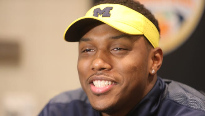 Michigan defensive end Taco Charlton talks with reporters on Wednesday, Dec. 28, 2016, in Fort Lauderdale, Fla.
