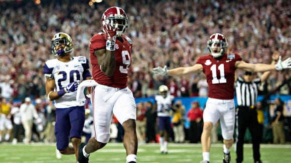 Alabama running back Bo Scarbrough (9) runs for a touchdown during the Peach Bowl playoff game between Alabama and Washington on Saturday, Dec. 31, 2016, at the Georgia Dome in Atlanta, Ga. Alabama defeated Washington 24-7.