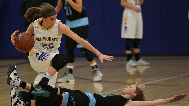 Mukwonago's Angie Cera is tripped by Arrowhead's Karina Smits on Tuesday.
