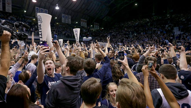 The Butler Bulldogs fans storm the court following their game Wednesday, December 4, 2016, evening at Hinkle Fieldhouse. The Butler Bulldogs defeated the Villanova Wildcats 66-58.
