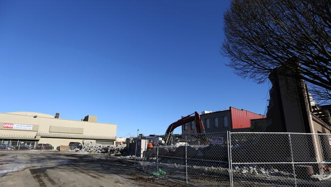Demolition has begun of 245 Court St. NE on preparation for a PDQ Investments, LLC development of a five-story mixed-use building with a proposed 40 apartments over 43,790 square feet, public records show. Photographed in downtown Salem on Thursday, Jan. 5, 2017.