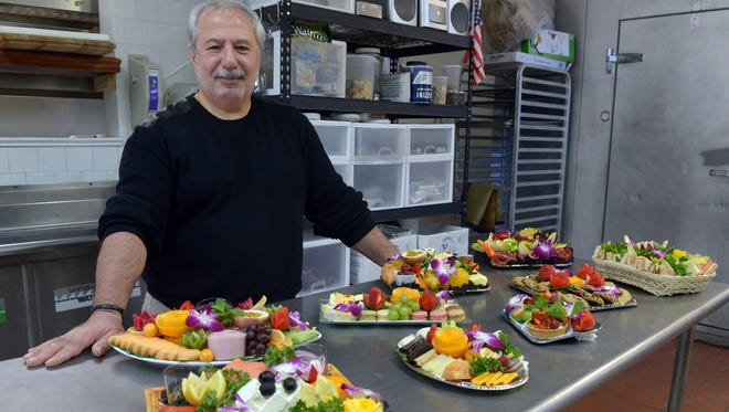 Harry Purut, who heads Gourmet Inflight Catering for private planes, in the kitchen of his business in Wood-Ridge.