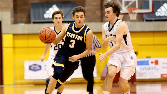 Stayton's Kurtys Hernandez (3) moves past Seton's Ben Owen (11) in the Stayton vs. Seton Catholic boy's basketball game on the first day of the Capitol City Classic tournament at Willamette University in Salem on Wednesday, Dec. 21, 2016. Stayton won the game 62-58.