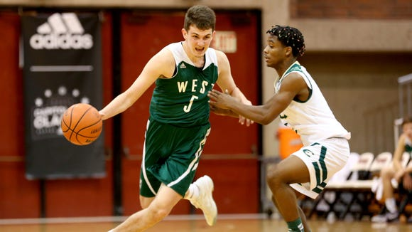 West Salem's Kyle Greeley (5) drives past Evergreen's Tre Ratcliff (1) in the West Salem vs. Evergreen boy's basketball game on the first day of the Capitol City Classic tournament at Willamette University in Salem on Wednesday, Dec. 21, 2016. West Salem won the game 72-52.
